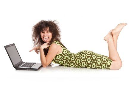 beautiful girl with the laptop lies on a floor isolated on a white background photo