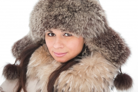 Beautiful young girl in fur clothing laughing photo