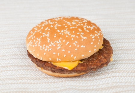 Delicious hamburger with lots of cheddar Stock Photo