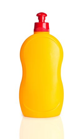 Yellow plastic bottle isolated on a white background photo