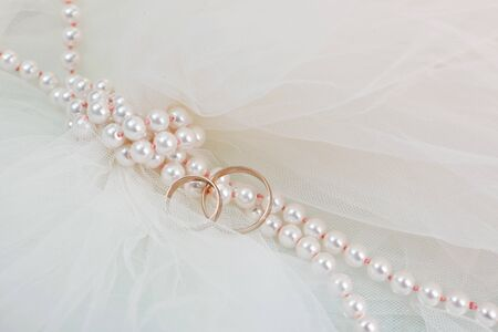 Wedding rings and a pearl necklace Stock Photo - 14804661