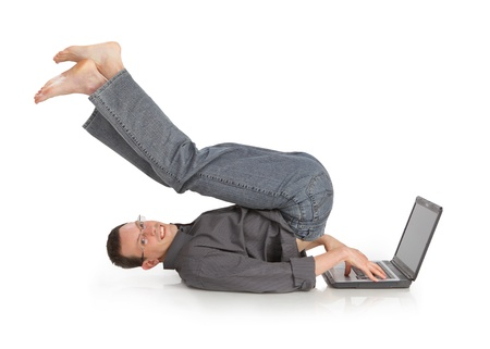 flexible cheerful guy with the laptop isolated on a white background