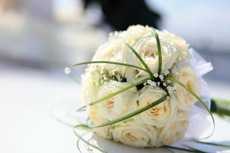 wedding accessories: The beautiful bouquet of the bride executed from light beige roses Stock Photo