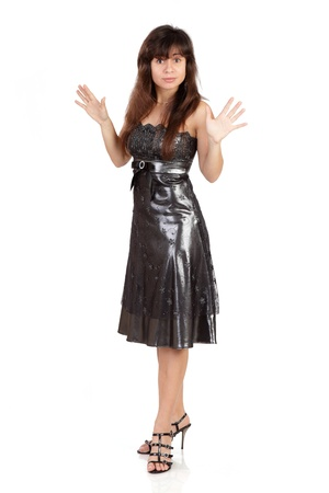utmost: The surprised girl costs to the utmost in a black dress, the brunette