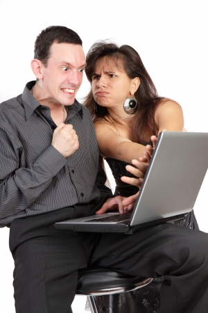 The guy and girl with the laptop isolated on a white background Stock Photo - 14802677