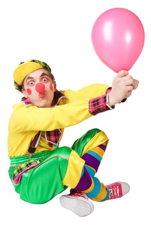 clown with a balloon in a hand isolated on a white background