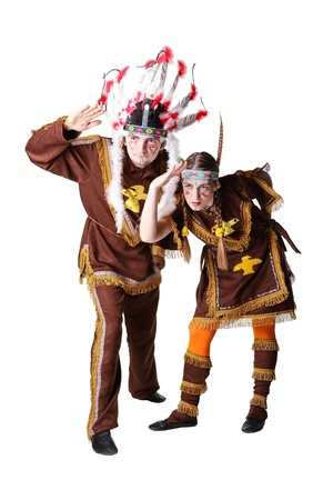 headdresses: Man and woman in american indian costume in studio isoated on a white background Stock Photo