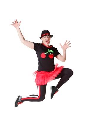 beautiful girln  with hat jumping in studio Stock Photo - 17276398