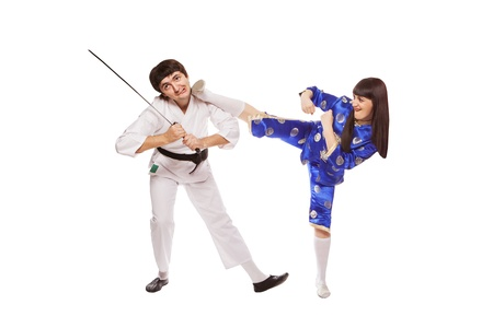 martial arts woman: Sparring.Sport.Kara te.Training fight.two fighters on a white background