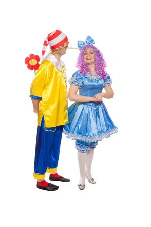Couple of happy clowns in Pinocchio and Malvina suits. Isolated on white Stock Photo - 17451905