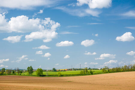 Beautiful landscape with yellow fields, blue sky and amazing clouds
