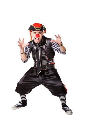 Clown in a pirate suit isolated on a white background photo