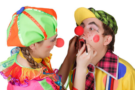 Couple of happy clowns isolated on white background photo