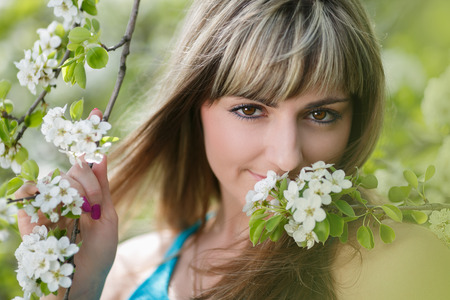 Blonde Girl with Cherry Blossom  Spring Portrait  Beautiful Young Woman with Sakura  Outdoor photo