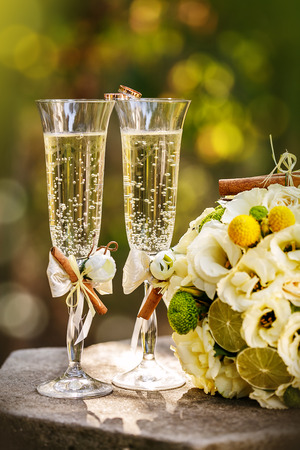 Wedding rings with roses and glasses of champagne photo