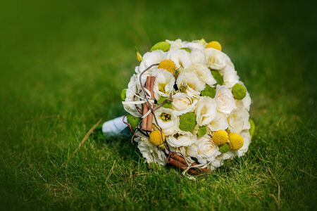 lime blossom: Wedding bouquet from beige roses, cinnamon, a lemon, a lime on a green grass