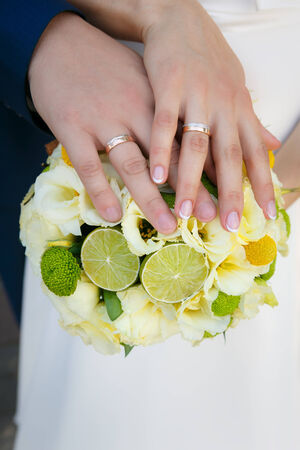 lime blossom: Wedding bouquet in hands of the bride and groom