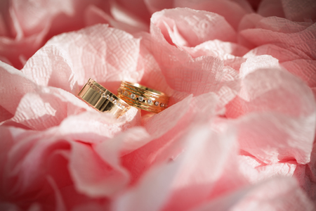 wedding ring in flowers background photo