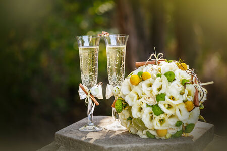 lime blossom: Wedding rings with roses and glasses of champagne