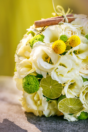 Wedding bouquet from beige roses, cinnamon, a lemon, a lime Imagens