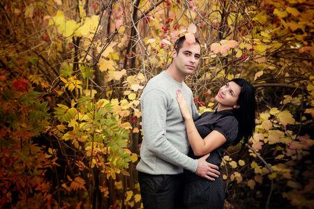 lovely couple in autumn park photo