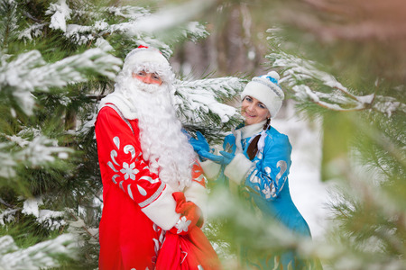 Russian Christmas characters: Ded Moroz (Father Frost) and Snegurochka (Snow Maiden) with gifts bag photo