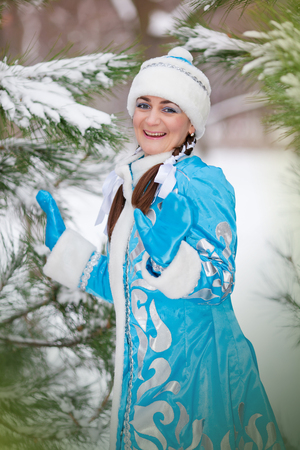 Portrait of the girl in a cap in the winter in the wood photo