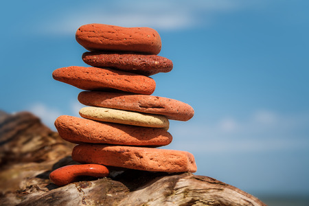 balanced rocks: Stack of red stones on tropical beach