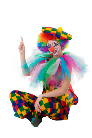 Funny clown pointing happily upward onto copy space photo