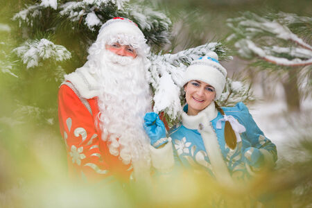ded moroz: Russian Christmas characters: Ded Moroz (Father Frost) and Snegurochka (Snow Maiden) with gifts bag