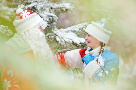 snegurochka: Russian Christmas characters: Ded Moroz (Father Frost) and Snegurochka (Snow Maiden) with gifts bag