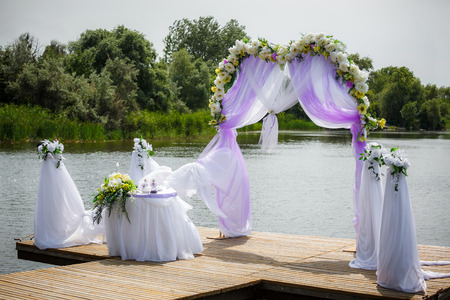 Beautiful wedding arch on the beach photo
