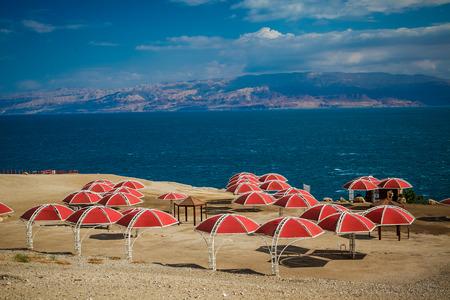 Umbrellas on Sandy Beach of Dead Sea, Israel, photo
