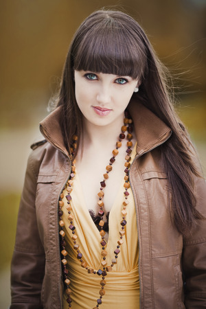 Portrait of attractive young brunette photo
