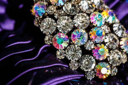 jewlery: brooch with brilliant stones on violet fabric