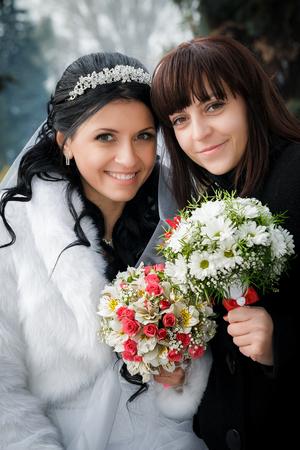 bridesmaid: Beautiful bride with her pretty bridesmaid Stock Photo