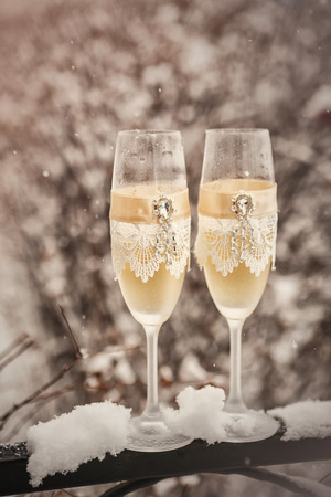 champers: Two glasses with champagne  on the snow Stock Photo