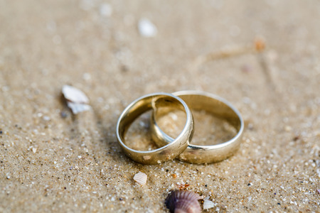 wedding symbol: Wedding concept - wedding rings lie on sand