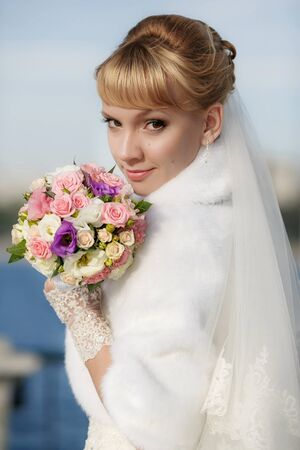bride: Beautiful bride in white fur coat