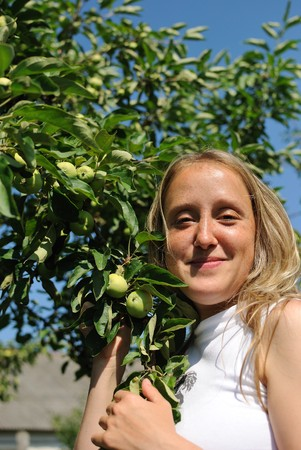 The girl with apple-tree Stock Photo