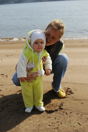 Mother with the child on a beach Stock Photo