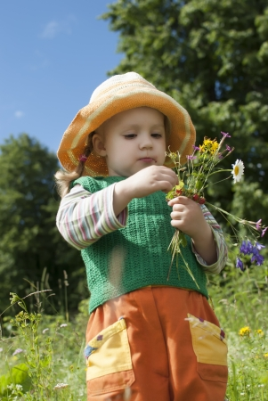3 persons only: the little girl with wild strawberry