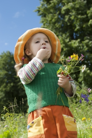 the little girl with wild strawberry