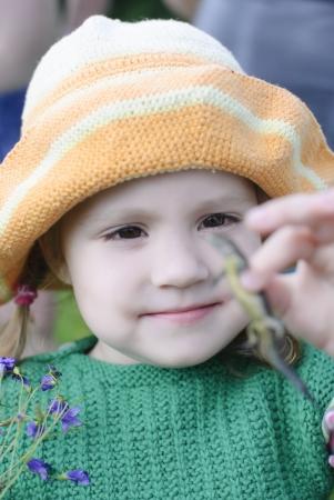 the girl holds a lizard