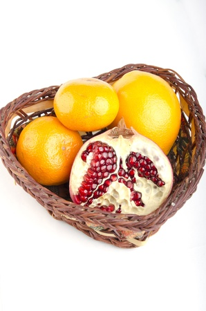oranges with pomegranate in a basket