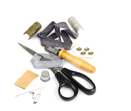 tools of the tailor on a white background