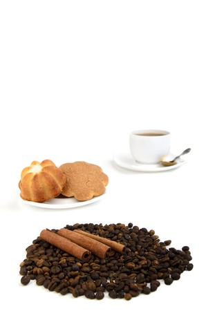 Coffee cup, cinnamon, anise on coffee beans, sweets on the background Stock Photo