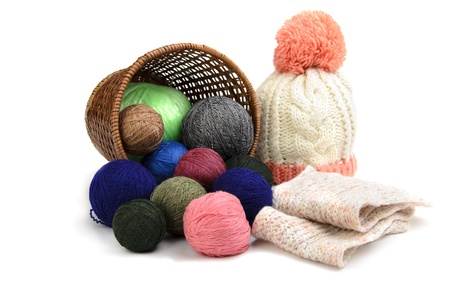 Sweaters and balls of wool isolated on white Stock Photo