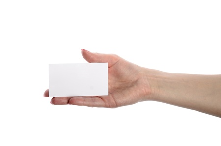 hand business card: Close-up of an empty business card in a womans hand isolated on white Stock Photo