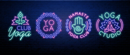 yoga neon sign isolated on brick wall Imagens - 101054223